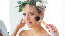 "Inspired by an English garden, this look features flushed cheeks, ""just bitten"" lips, and all things rose and blush pink on the face. To top it off? A whimsy updo topped with a floral crown (this one done up right by Dilly Lily). For the bohemian bride or the hopeless romantic, the makeup focuses on softening the face and opening up the eyes."