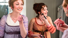 "Hello, young lovers! The Chicago Shakespeare Theatre is all about romance this month as they debut a world premiere musical based off of Jane Austen's intimate love story Sense and Sensibility. And at the heart of the sweet story—don't worry, we won't judge you if you've only pretended to read the book—are veteran actresses Megan McGinnis and Sharon Rietkerk.  Megan's portrayl of the hopeless romantic Marianne and Sharon's more straight-laced Elinor give composer Paul Gordon's stunning score life and lyricism—and chemistry to boot! Playing the opposites-attract Dashwood sisters as they navigate the throes of love (and passion!) in the show has been an easy transformation as the two actresses have shared the stage as siblings in the past. ""It's easy playing the sister to this one,"" Sharon says of working with Megan, ""And the best part? There's no drama!"""