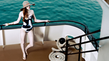 Summertime fun—and then some! We board the Odyssey Chicago to experience high fashion at the high sea. With Lake Michigan and the chic black-and-white striped Odyssey as our backdrop, we're making a splash with the season's latest—and saltiest!—swimwear. From Karla Colletto's sporty zipper-detailed diver to Kate Spade's fresh beach stripe bralette, our red-haired siren beauty wears summer's swim with a confidence akin to a sure-footed boat captain. Full speed ahead! This is one swim story worthy of you land lovers, too.